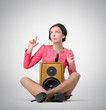 Young woman relax with speaker