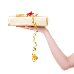 Hand giving christmas golden gift box with ribbon. Holiday.