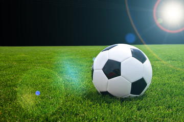 Soccer ball in spotlight