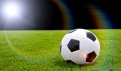 Soccer ball with bright lens flare