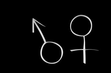 Male and female gender symbols, mars and venus on black.