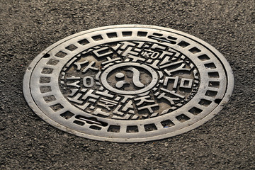 manhole on the street in Seoul, South Korea