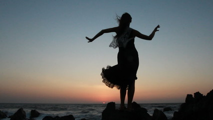 Silhouette of the woman dancing