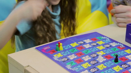 Excited child playing board game, learning process, upbringing