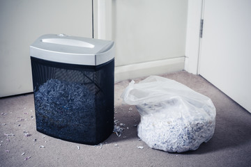 Paper shredder and bag of shredded documents