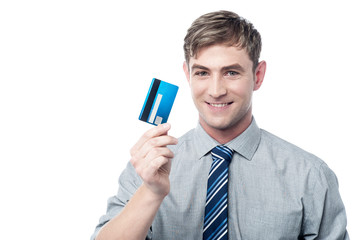 Cheerful young executive holding credit card