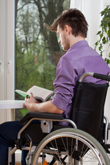 Disabled reading a book