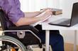 Man on wheelchair during work