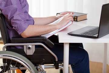 Man on wheelchair during work