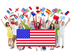 Group Of Multi-Ethnic Group Of People Holding National Flags Wit