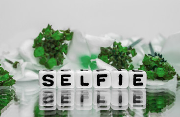 Selfie with green flowers