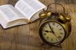 Leinwandbild Motiv Bible with clock on wood