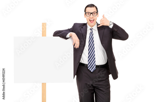 Businessman standing by a blank banner