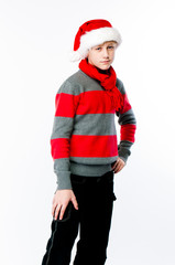 the young boy in the cap of santa claus