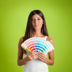 Young woman portrait with colors palette against colorful green