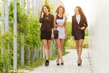 Three  business woman walking down the street