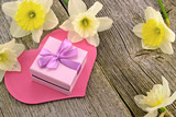 Gift with hearts and flowers