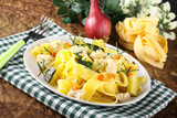 Pasta with fish, zucchini and carrots