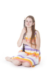 sitting girl with oboe against white background
