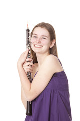 smiling girl in purple dress with oboe