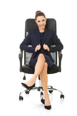Business woman sitting in chair.