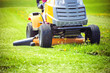 Closeup of mower cutting the grass - 65498618