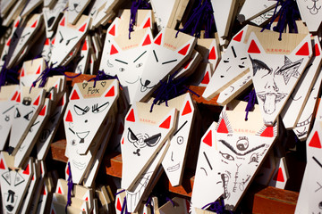 Fox shaped praying cards at Fushimi Inari shrine, Kyoto, Japan.