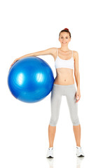 Fitness girl holding pilates ball