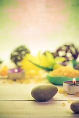Zen stones scented candle wooden background