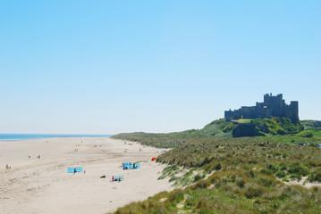 Bamburgh castle and beach on hazy summer day