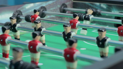 Close-up view table soccer figures, team-building, having fun