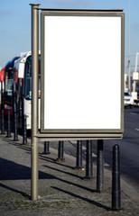 Blank billboard on city bus station