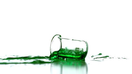 Beaker falling and spilling green liquid