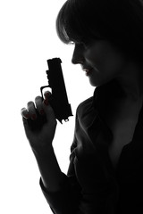 sexy detective  woman holding aiming  gun silhouette