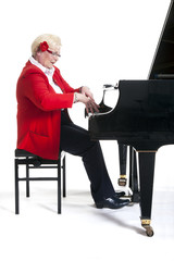 older lady in red playing the grand piano