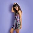 Beautiful woman portrait against colorful purple background.