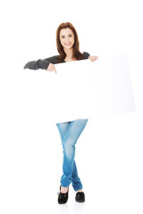 Portrait of happy woman with blank board