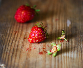 juicy strawberry on a wooden surface