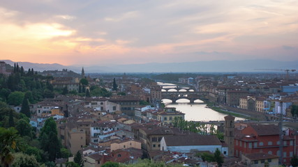 View of Gold (Ponte Vecchio) Bridge in Florence on a sunset, tim