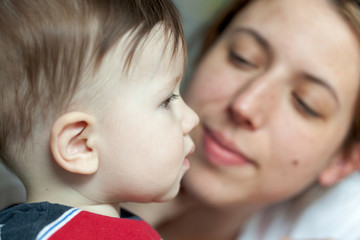 Close-up of a woman kissing her son