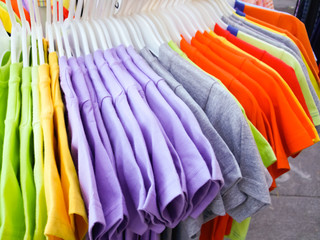 Assorted t-shirts at a clothing store