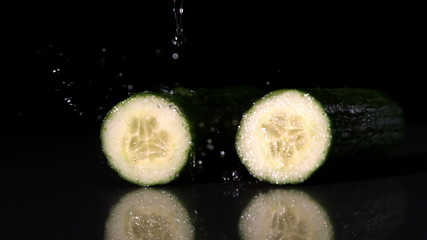 Water raining on courgette halves