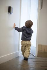 Boy using a card key to open a door