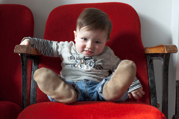 Baby boy sitting on a chair