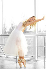Beautiful balerina practicing in ballet class