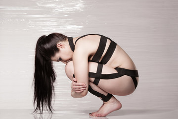 Beauty sexy girl like Leeloo Dallas from film, bdsm