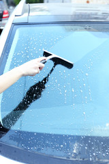 Hand washing car window