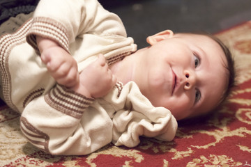 Close-up of a baby boy playing