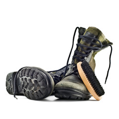 army boots and shoe brush