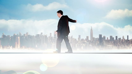 Businessman walking across tightrope with success text